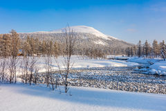 Winter beautiful day landscape with river and mountain Stock Images