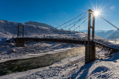 Winter. Beautiful old bridge. Sun Stock Photography