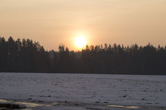Winter. A beautiful sunrise over the forest. The photo sunrise over the winter forest stock illustration