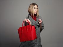 Winter beautiful Woman with Handbag.Beauty Fashion Girl in topcoat Royalty Free Stock Photos