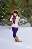 Winter beautiful woman on snow Royalty Free Stock Images