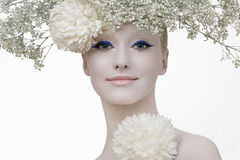 Winter beauty. Model in an image of the winter, created by means of a make-up, Body- Art and floristics art on a white background Royalty Free Stock Photo