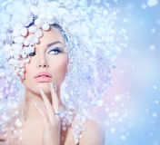 Winter Beauty. Beautiful Fashion Model Girl with Snow Hair style
