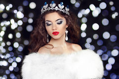 Winter Beauty Fashion Girl model in fur coat over boker Christma Royalty Free Stock Photo