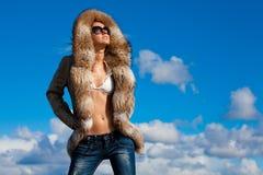 Winter beauty in fur coat Stock Image