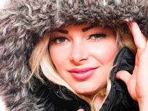 Winter beauty. A image of a attractive woman wearing a fur lined hood looking into the camera stock photos