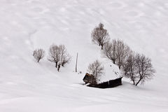 Winter beauty with small cottage and snow Stock Photos