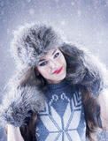 Winter beauty woman in a fur hat and mittens. Royalty Free Stock Photos