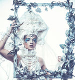 Winter beauty woman. Holiday makeup. Winter Queen with snow and ice hairstyle Royalty Free Stock Photos