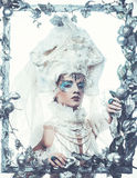 Winter beauty woman. Holiday makeup. Winter Queen with snow and ice hairstyle Stock Photo