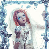 Winter beauty woman. Holiday makeup. Winter Queen with snow and ice hairstyle Royalty Free Stock Image