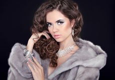 Winter beauty woman in mink fur coat. Fashion girl model portrai Royalty Free Stock Image