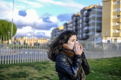 Winter woman portraits walking in park, sick woman royalty free stock photography