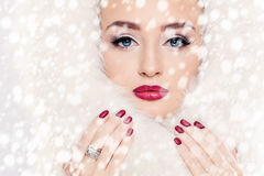 Winter Beauty. Woman and Snow Royalty Free Stock Images