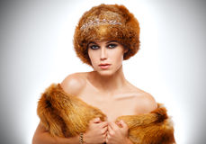 Winter beauty young woman portrait. Beauty Fashion Model Girl in Fox Fur Coat. Beautiful Woman in Luxury Red Fur Jacket Stock Image