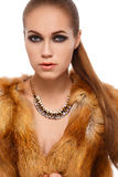 Winter beauty young woman portrait. Beauty Fashion Model Girl in Fox Fur Coat. Beautiful Woman in Luxury Red Fur Jacket Royalty Free Stock Image