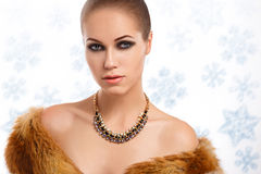 Winter beauty young woman portrait. Model creative image with frozen makeup, with porcelain skin and long white lashes showing trendy, Ice-queen, Snow Queen Royalty Free Stock Photo