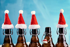 Winter beer bottle merry christmas party. Beer Bottles in a row with funny christmas hats for xams happenings stock images