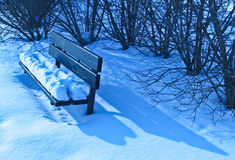Winter bench. Snowy bench on a late afternoon, Helsinki, Finland stock photography