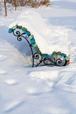 Winter bench covered with snow Stock Images