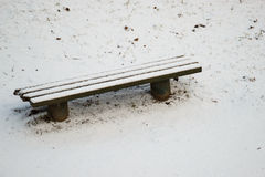 Winter bench covered with snow. Stock Photos