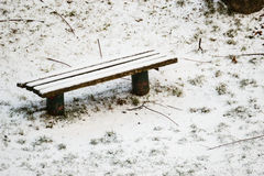 Winter bench covered with snow. Royalty Free Stock Photography