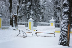 Winter bench covered snow Stock Photo