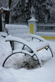 Winter bench covered snow Royalty Free Stock Photo