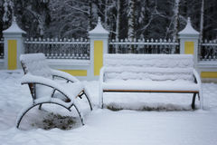 Winter bench covered snow Royalty Free Stock Images