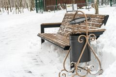 Winter bench covered with snow. Winter park.  Royalty Free Stock Photo