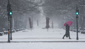 Winter in Berlin City with walking People on the Street and Snowfall royalty free stock photos