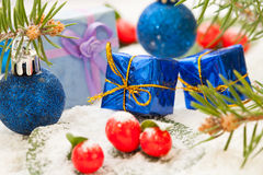 Winter berries with Christmas presents Stock Photo