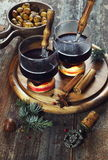 Winter beverage: hot wine and roast chestnuts Stock Photography