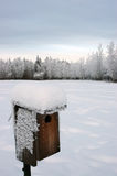 Winter bird house. Bird house with snow and ice crystals Stock Images