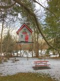 Winter Bird House. Hanging from the tree royalty free stock photos