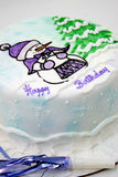 Winter birthday cake. White birthday cake with snowflakes, snowman and a tree Royalty Free Stock Photography