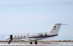 Winter bizjet. Private jet awaiting passengers at an airport in the winter Royalty Free Stock Photo