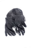 Winter black Knit Gloves and warm hat on a  snow Stock Images