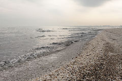 Winter black sea beach in winter sky landscape. Winter black sea beach in winter grey sky landscape Stock Image