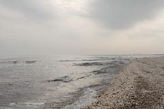 Winter black sea beach in winter sky landscape. Winter black sea beach in winter grey sky landscape Stock Photo