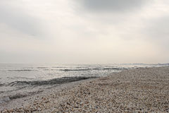 Winter black sea beach in winter sky landscape. Winter black sea beach in winter grey sky landscape Royalty Free Stock Image