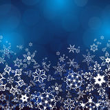 Winter blue background with ornate snowflakes Royalty Free Stock Photography