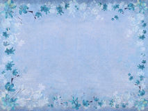 Winter blue blossom flower border. On blue textured background with text space Royalty Free Stock Photography