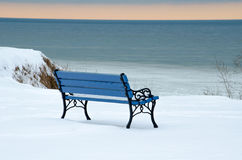Winter blue park bench: shades of blue stock photos