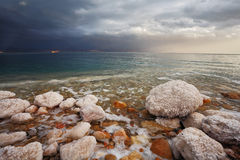 Winter. Blue storm cloud on the Dead Sea Stock Image