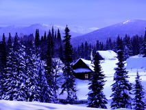 Winter blue twilight in the mountains Stock Photos
