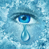 Winter Blues. Seasonal affective disorder or depression and cold grey season lonesome anxiety and emotional crisis concept as a human eyeball crying a tear Royalty Free Stock Image