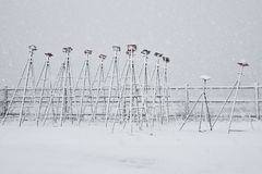 Winter Boat Jack Stands. Rows of jack stands for boats lined up at the marina during a snow storm Royalty Free Stock Image