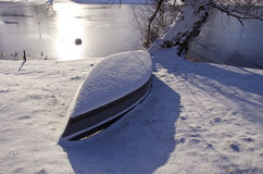 Winter Boat Under Snow Stock Photo