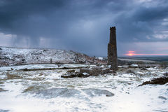 Winter on Bodmin Moor. Stormy sunrise over abandoned mine buildings at the foot of Caradon Hill at Minions on Bodmin Moor in Cornwall Royalty Free Stock Images